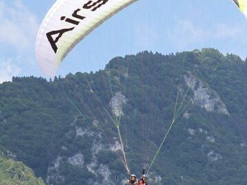 Experience (price per person): Two-seater paragliding flight
